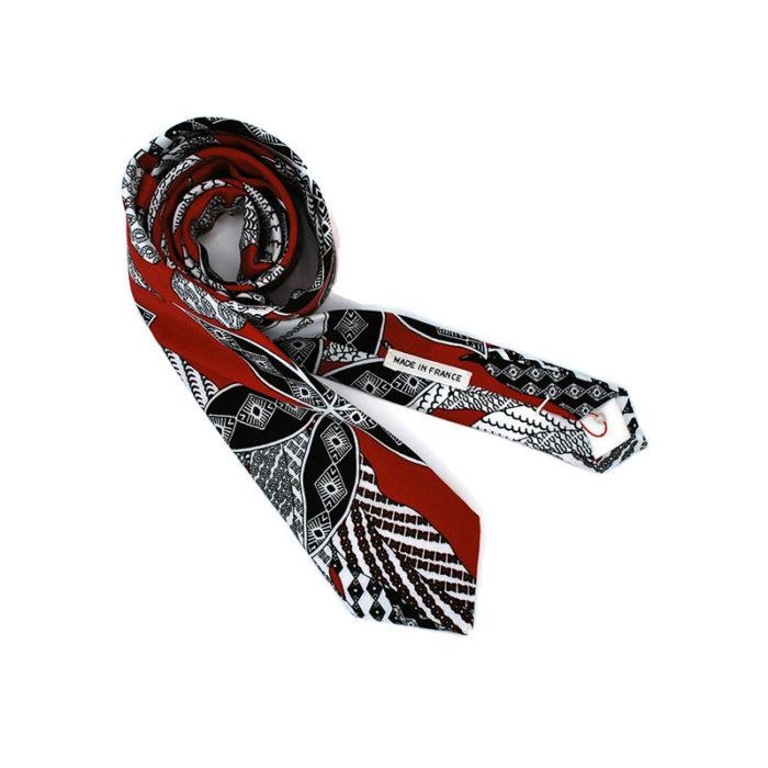 Voici la cravate Volte Face orange de la brigade du noeud.